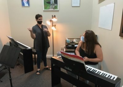Christina instructing a piano student